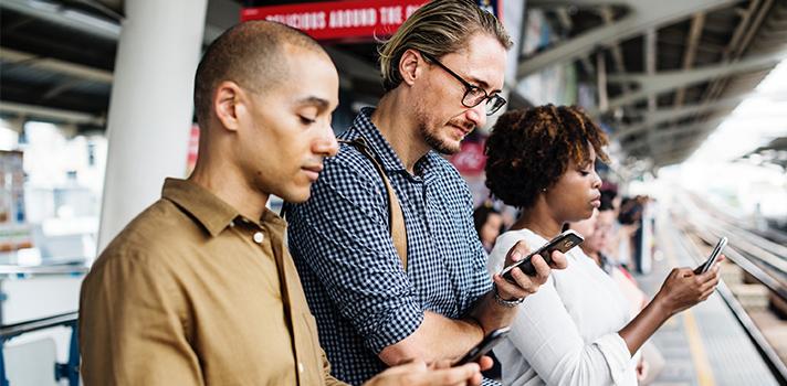 People using emojis on their phones.